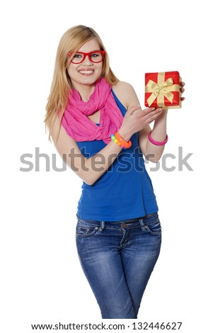 Teen girl with gift at white background - stock photo