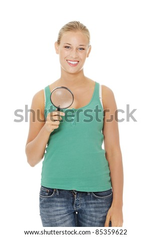 Teen girl with magnifier .Isolated on white background. - stock photo