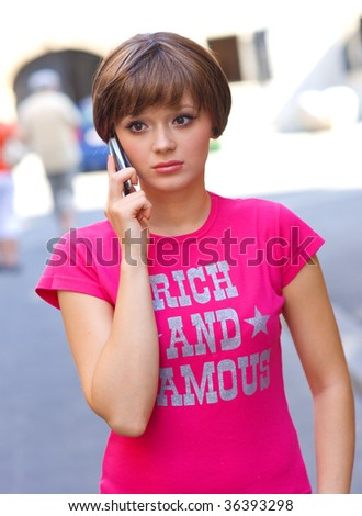 teen girl with worried expression talking to mobile phone - stock photo