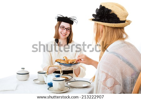 Teen girls having a tea party together.  White background.   - stock photo