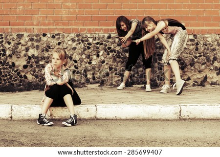 Teen girls in conflict at the school building - stock photo