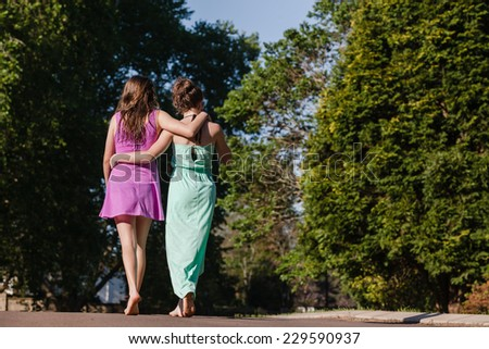 Teen Girls Walking Hangout Teenagers girls hangout summers day home walk talk laugh playtime - stock photo