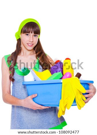 Teen holding basin full with detergents and fibers - stock photo