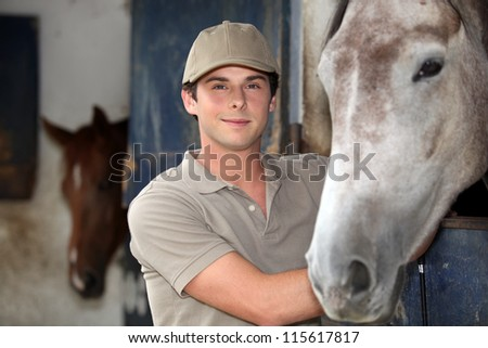 Teen in equestrian center - stock photo