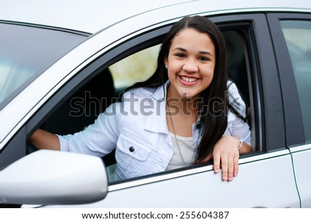 Teen in her new car going for a drive - stock photo