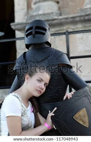 Teen is embracing the knight in Rhodes old town, Greece - stock photo