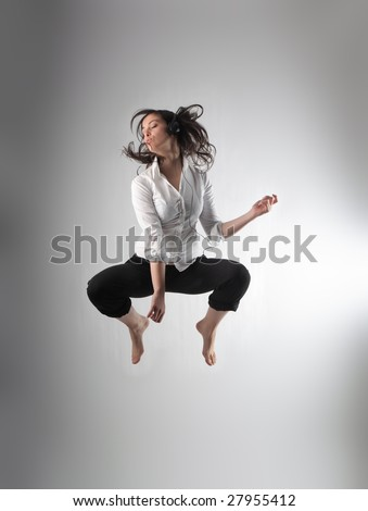 teen listening music and jumping - stock photo