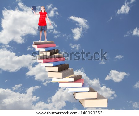 Teen on top of book stair case holding book with clouds as background - stock photo