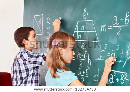 Teen school child sitting on desk in classroom. - stock photo