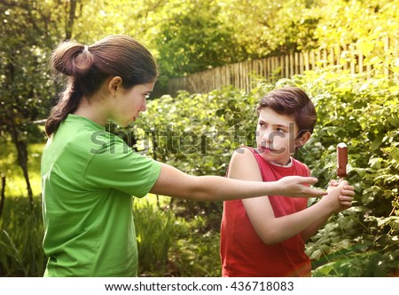 teen siblings couple boy and girl quarreling because of ice-cream - stock photo
