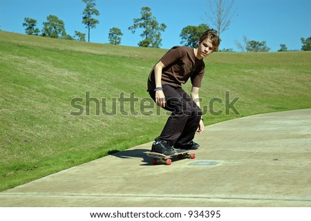 Teen Skaterboarder Downhill - stock photo