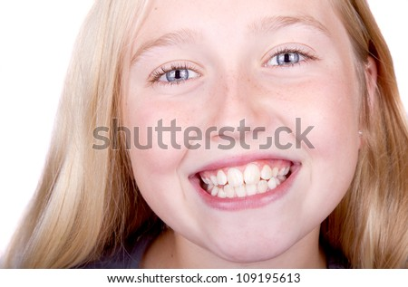 teen smiling close up of eyes and mouth, isolated on white - stock photo