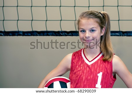 Teen volleyball player displaying can-do, aggressive approach - stock photo
