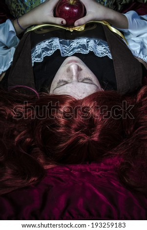 Teen with a red apple lying, tale scene romantic - stock photo