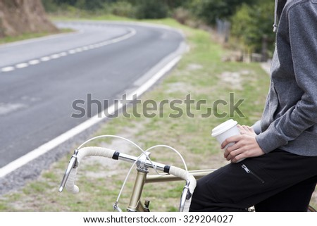 Teen with bike outdoors - stock photo