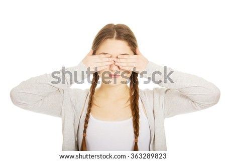 Teen woman covering her eyes. - stock photo