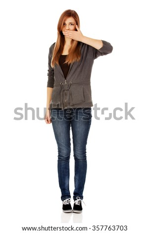Teen woman covering her mouth with hand. - stock photo