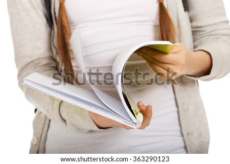 Teen woman reading her notebook. - stock photo