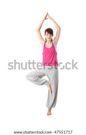 Teen woman training yoga, isolated on white - stock photo