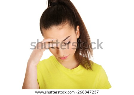Teen woman with a headache holding head. - stock photo