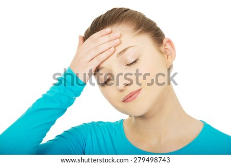 Teen woman with headache holding her head. - stock photo