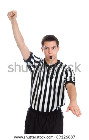 Teenage basketball referee giving sign for foul - stock photo