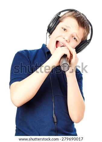 Teenage boy in headphones, singing into a microphone on a white background. Very emotional. - stock photo