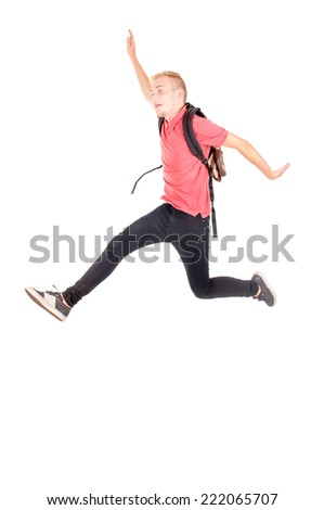 teenage boy jumping isolated in white - stock photo