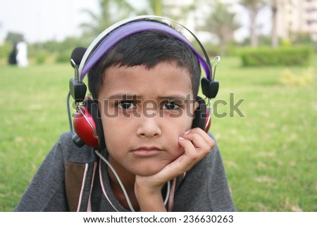 Teenage boy listening music - stock photo