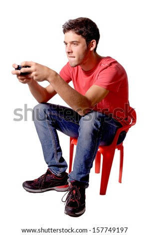 teenage boy playing video games isolated in white - stock photo