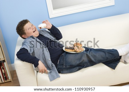 Teenage Boy Watching Television - stock photo