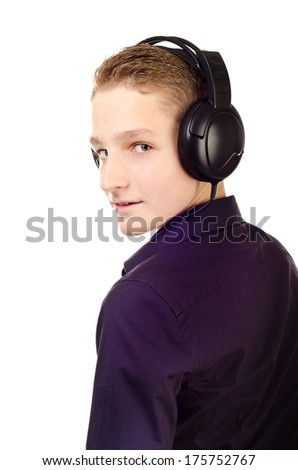 teenage boy with headphones isolated on a white background - stock photo