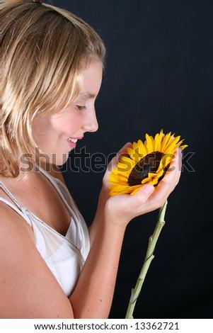 Teenage female model on a black background - stock photo