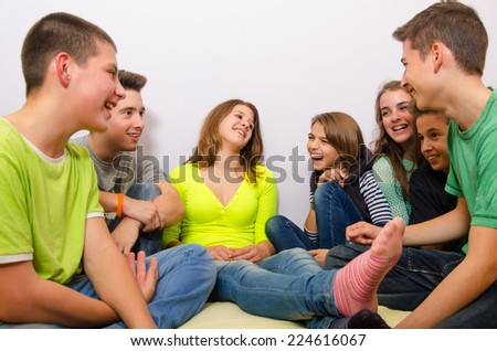 Teenage friends having fun at home. - stock photo