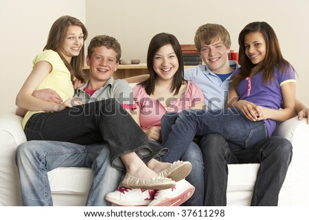 Teenage Friends Relaxing at Home - stock photo