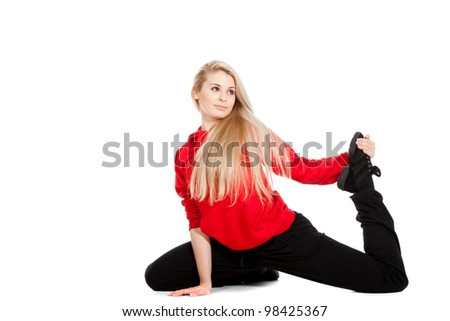 Teenage girl acrobatics gymnastic doing exercise, wearing red and black sportswear clothing, studio series, isolated over white background. - stock photo