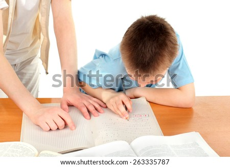 teenage girl and schoolboy on the table with exercise books - stock photo