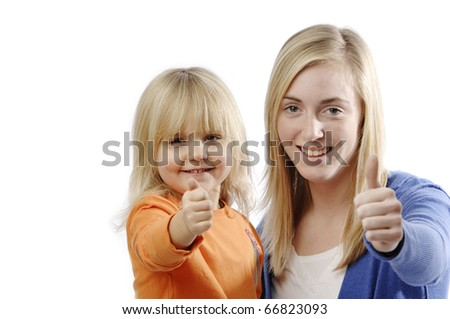 Teenage girl and toddler flash thumbs up - stock photo