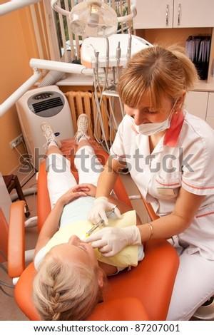 Teenage girl at the dentist. - stock photo