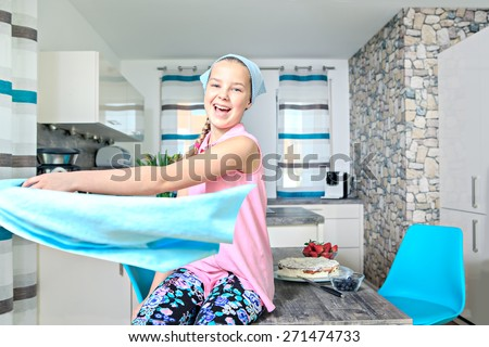 teenage girl baking a pie at home - stock photo
