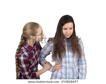 Teenage girl comforts girlfriend isolated on white background - friendship, sympathy and compassion concept - stock photo
