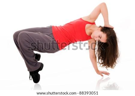 Teenage girl dancing hip-hop, isolated on white - stock photo