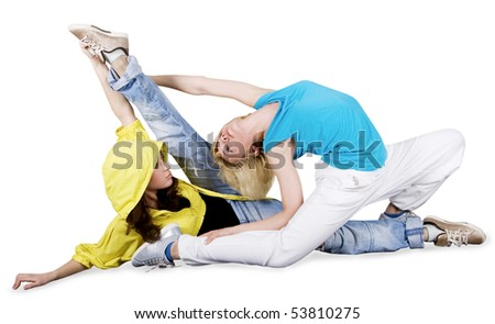 Teenage girl dancing hip-hop over white background - stock photo
