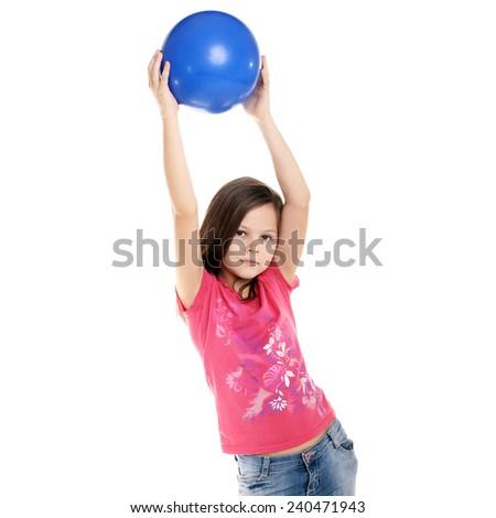 teenage girl doing exercises with a ball - stock photo
