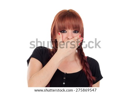 Teenage girl dressed in black with a piercing covering her mouth isolated on white background - stock photo