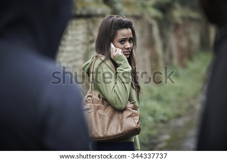Teenage Girl Feeling Intimidated As She Walks Home - stock photo