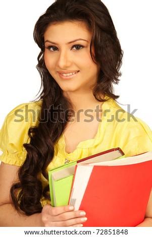 teenage girl holding books. Isolated on a white background. - stock photo