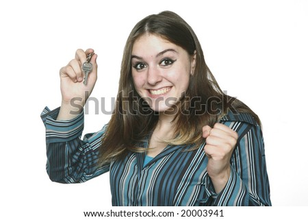 Teenage Girl Holding Key, looking excited. - stock photo