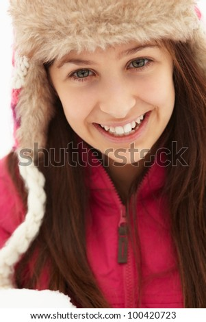 Teenage Girl Holding Snowball Wearing Fur Hat - stock photo
