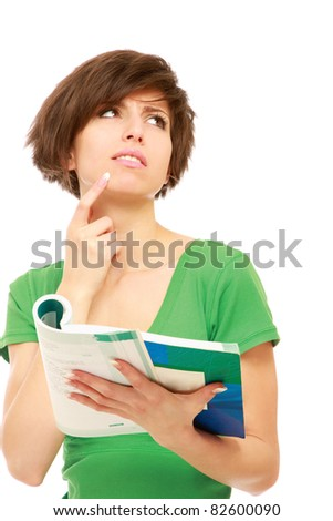 Teenage girl in glasses holding book and looking - stock photo